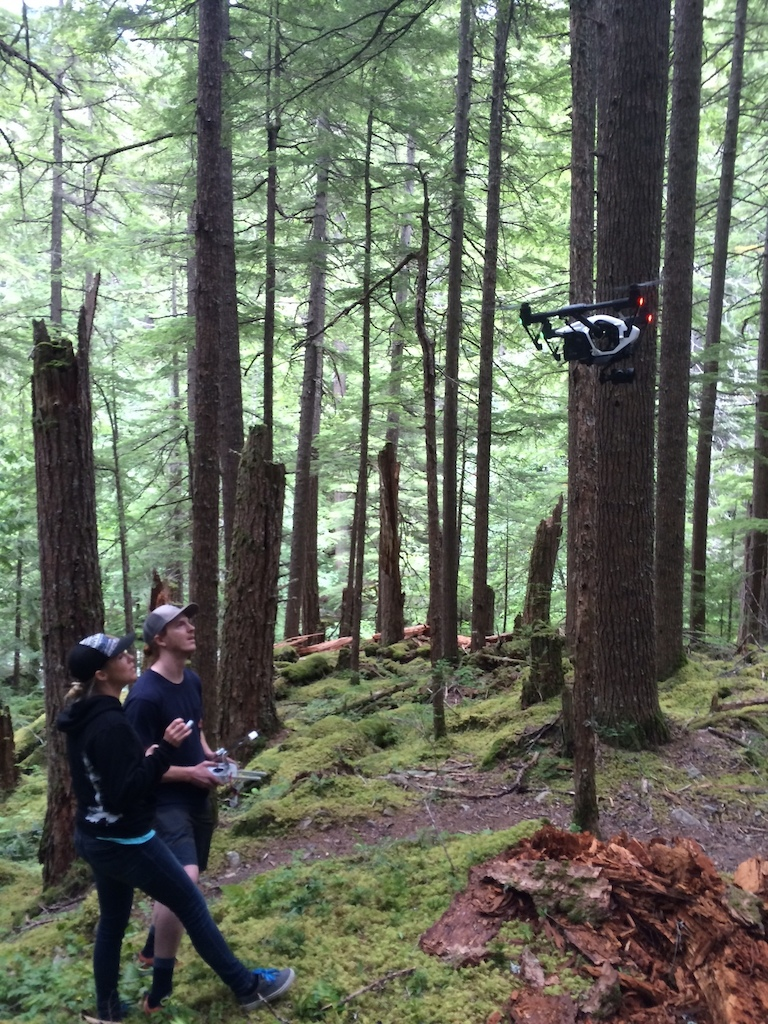 Lacy and Garret bring the drone in for a landing.