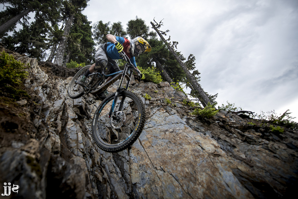 Jimmi dropping a shale descent at the Whistler Bike Park
