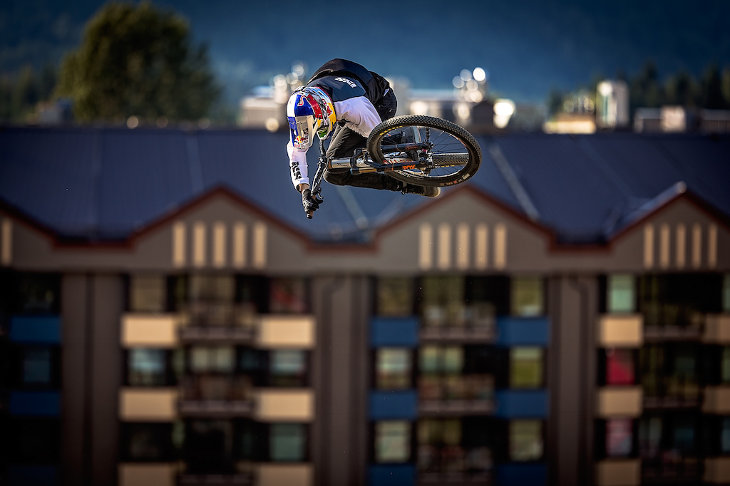 Thomas Genon pulls out a final trick against competitor Jakub Vencl on his way down the Crankworx Whistler, CLIF Bar Dual Speed & Style. Photo by Clint Trahan.