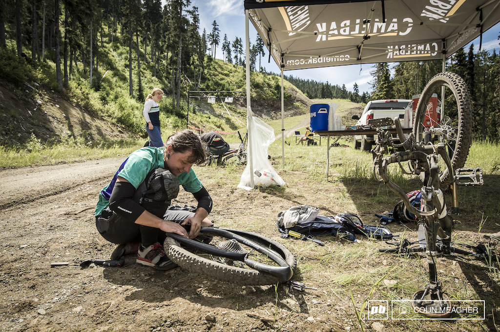 Fejola Stepanka Nestlerova shoving a tube into her wheel before getting on with the final stage of the Challenger Enduro.