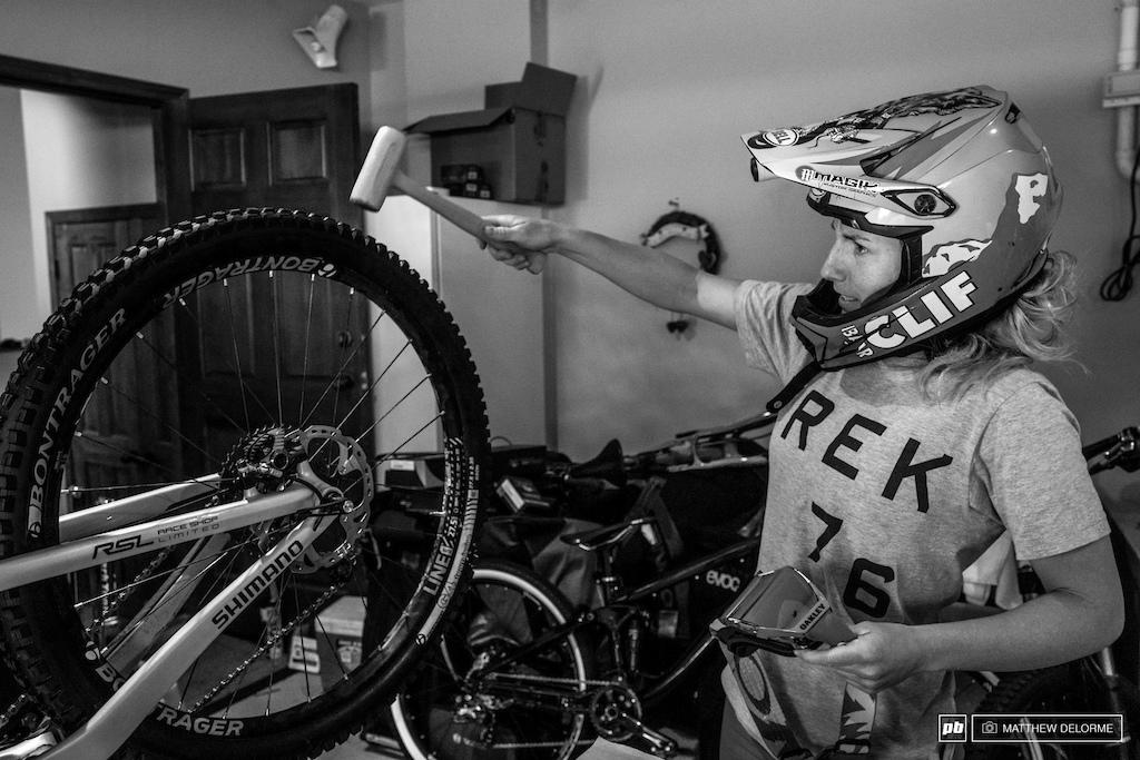 Brown gives her bike a final check with the most important tool in the kit. Pressures were good.