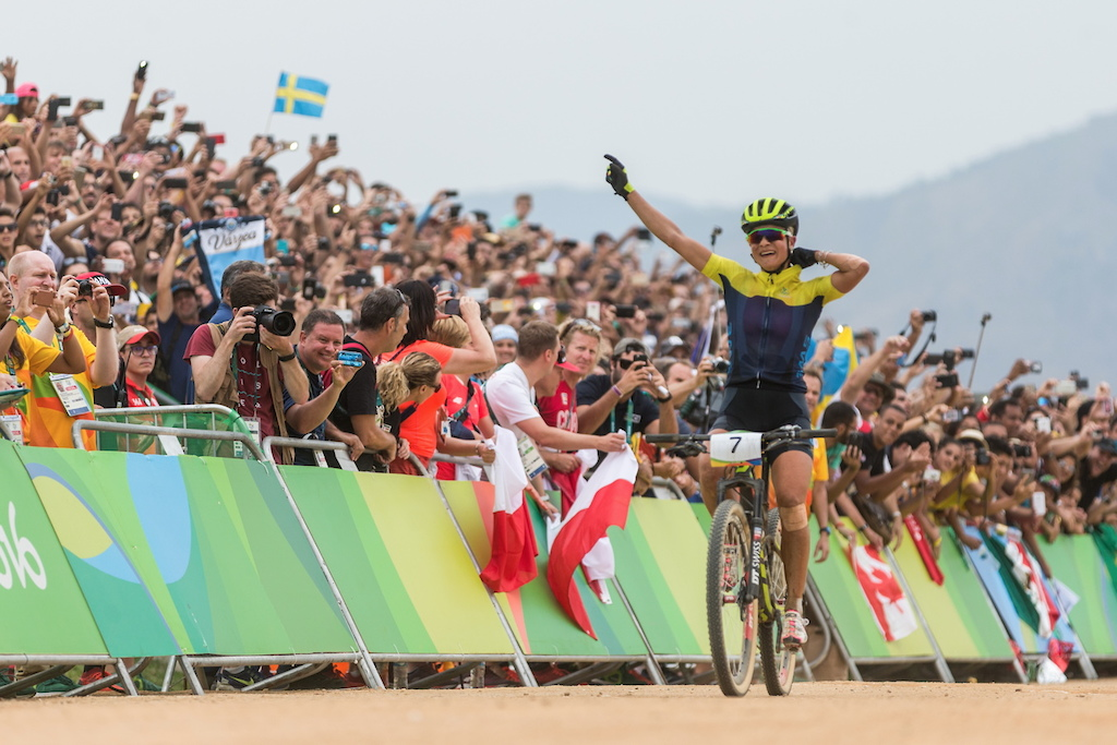 Jenny Rissveds celebrates her Olympic champion title in the finish line of the race. She is the youngest MTB Olympic champion.
