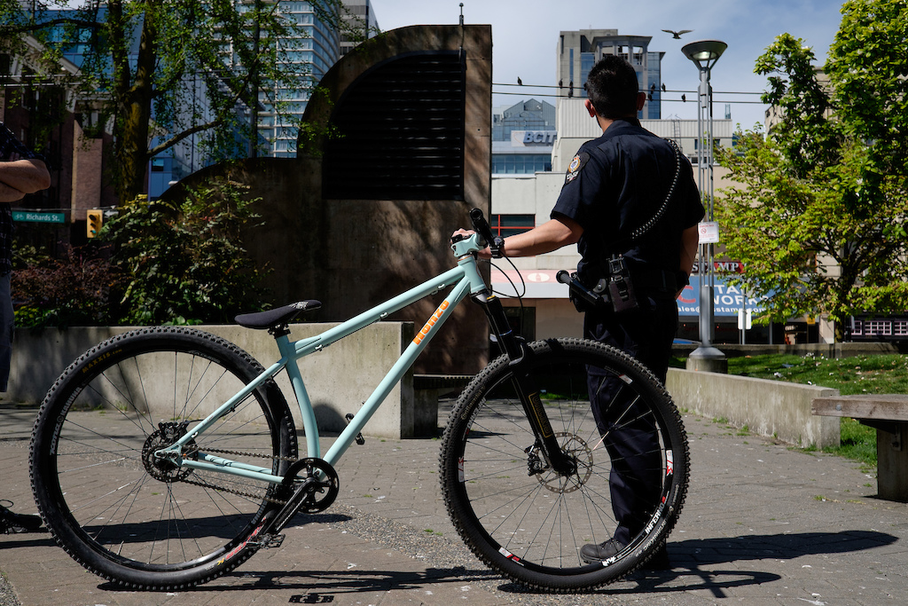 Photo J.L. Russell - VPD holding reclaimed stolen bike.