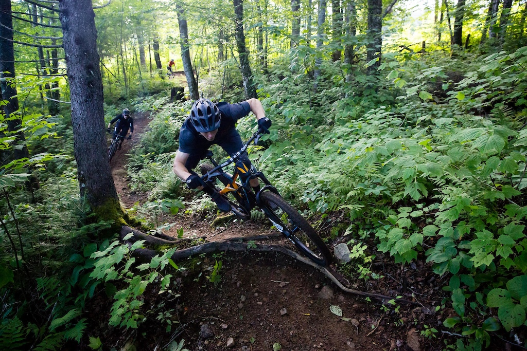 Mark floating over roots on the Boreal trail. PHOTO: Ben Gavelda