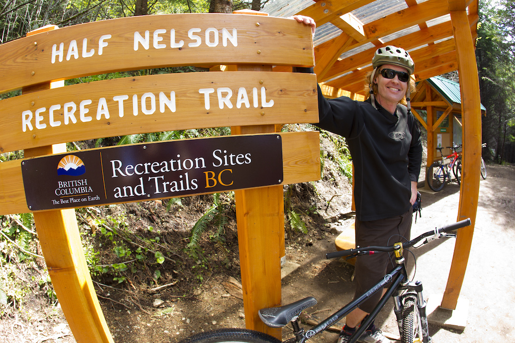 Ted Tempany poses with the Half Nelson trail sign. Photographer John Gibson
