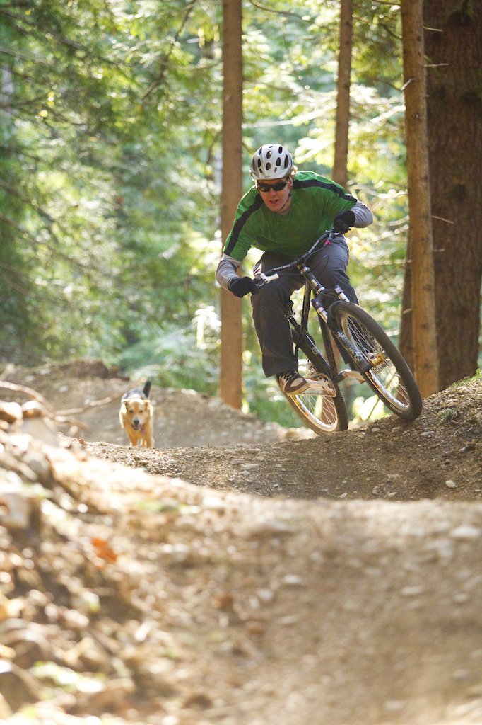 Trailbuilder Ted Tempany and Jackson rides the Half Nelson Trail. Photographer John Gibson