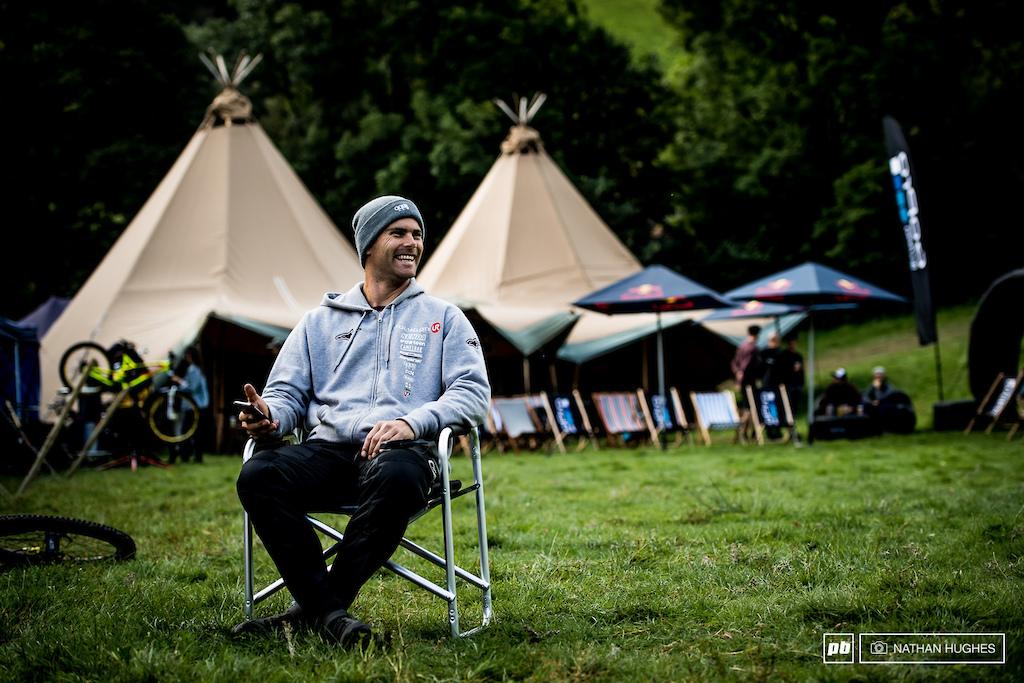 Mick Hannah smiles infront of the Redbull wigwams back down at base camp.