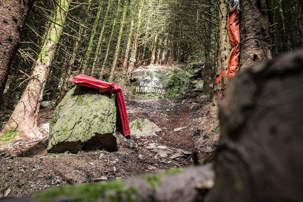 Hidden in the middle of the steep woods is this  rock drop, on any other course this would be considered a big feature at about 3m, but this is RedBull Hardline.