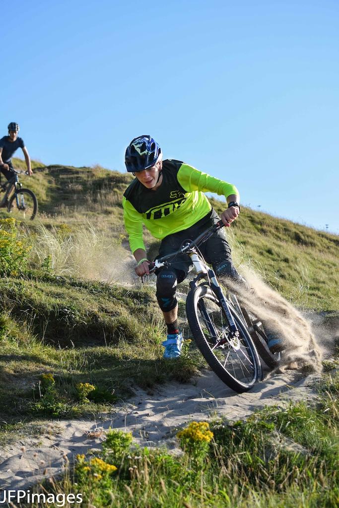 Jake Marsh sending some sand flying at Sennen cove in Cornwall