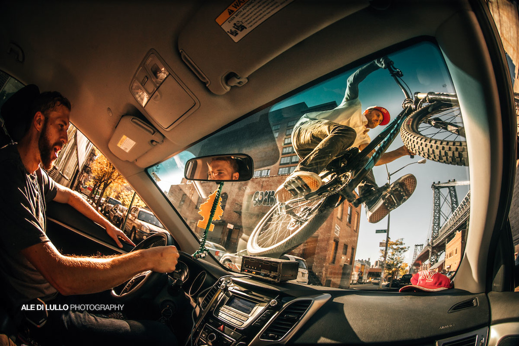 Aaron Chase shredding over a cab windshield in Brooklyn, NY.