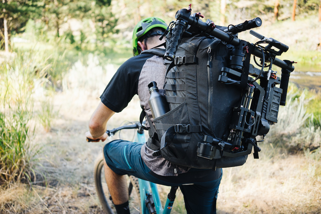 Riding with filming gear.