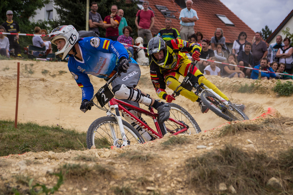 Two riders in the same turn - only allowed in a dual eliminator race - Photographer Nadine Maier