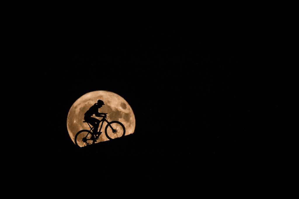Karla Stepanova climbing a hill in the super moon light.