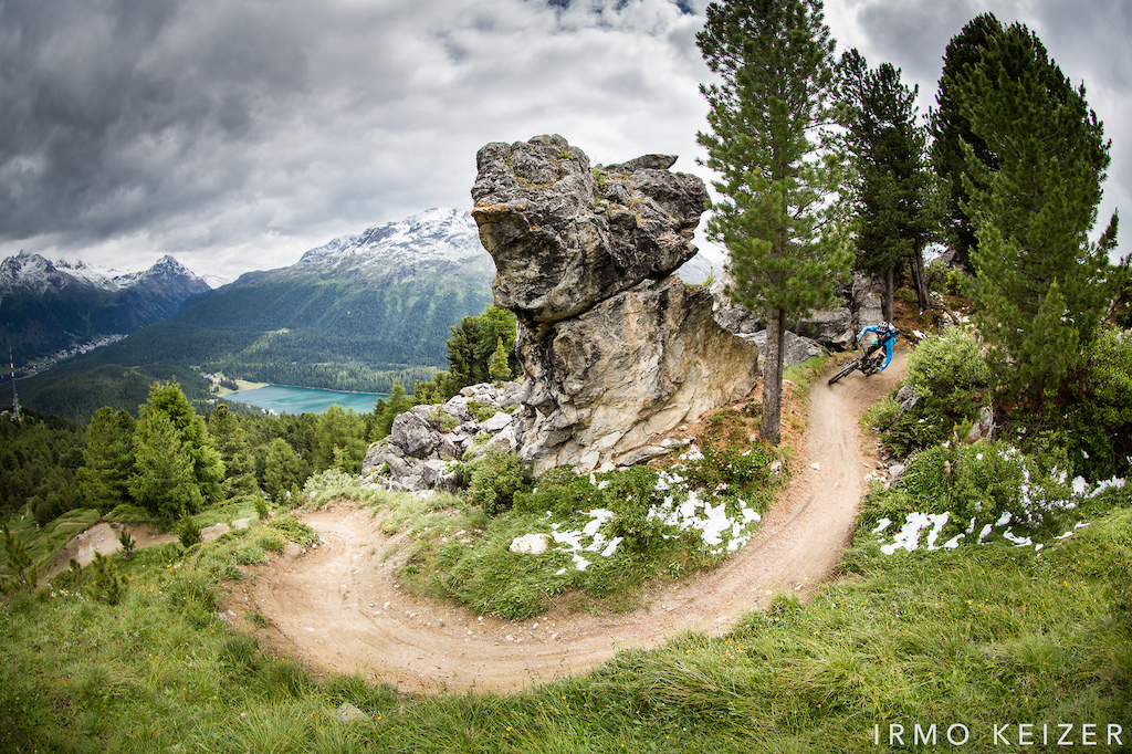 On a wintery summer day, Nicolas Baisin charges down the Corviglia flow trail above the Swiss town of St Moritz.