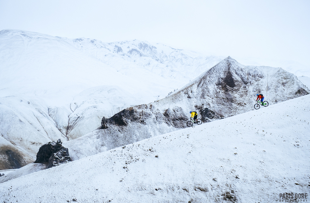 KC Deane and Geoff Gulevich in Landmannalaugar, Iceland. These hills are generally a vast landscape of orange colored rocks, but we caught this area during a mega snow storm and got the landscape captured in a way that is rarely seen.