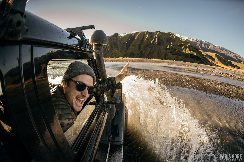 KC Deane driving through the valley smashing through rivers in the Land Rover.