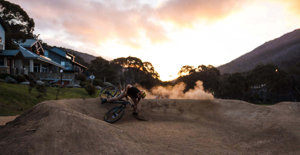 Pat slaying the berm with the sunset through the valley