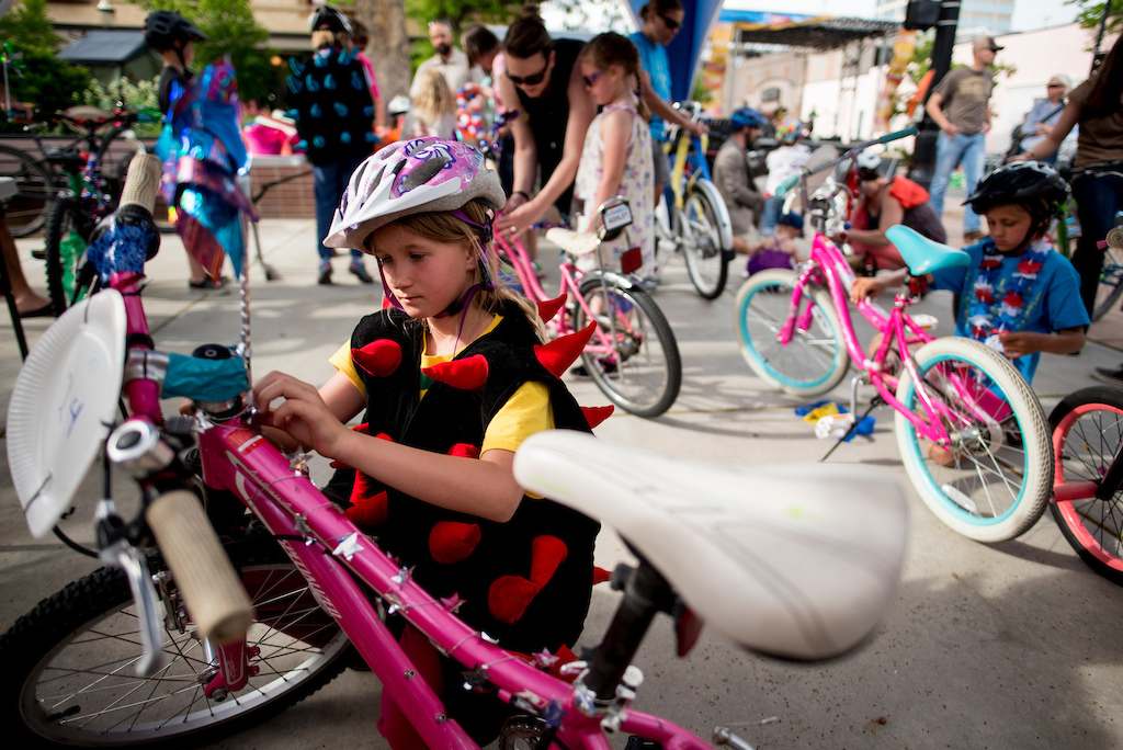 Kids decorate bikes for the Klunker Crit Friday.