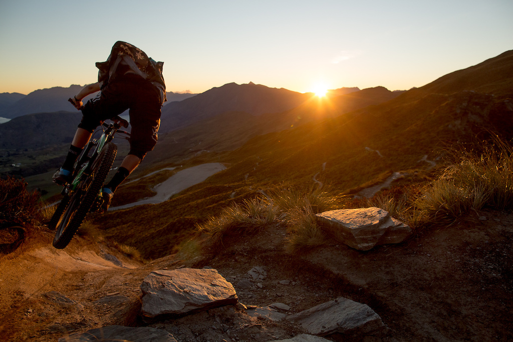 Monty airing into a chute on coronet peak at last light