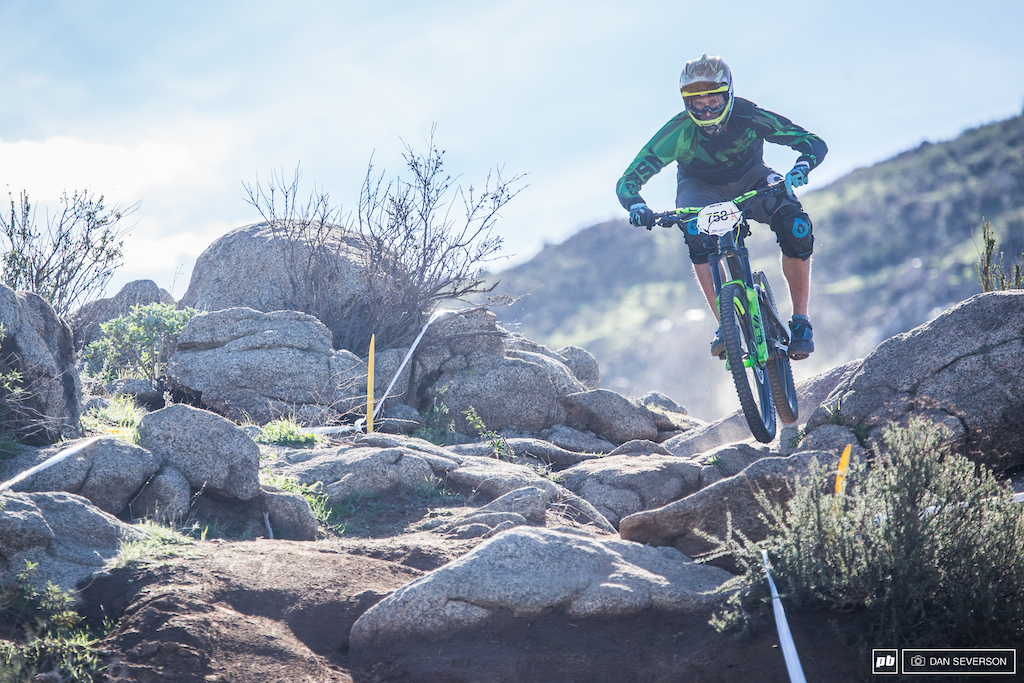 NS Bikes rider Michal Kollbek floats over a rock section.
