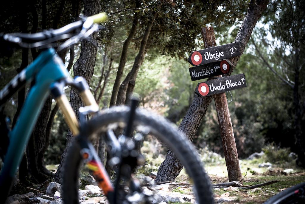 Trail signs on Brac island.