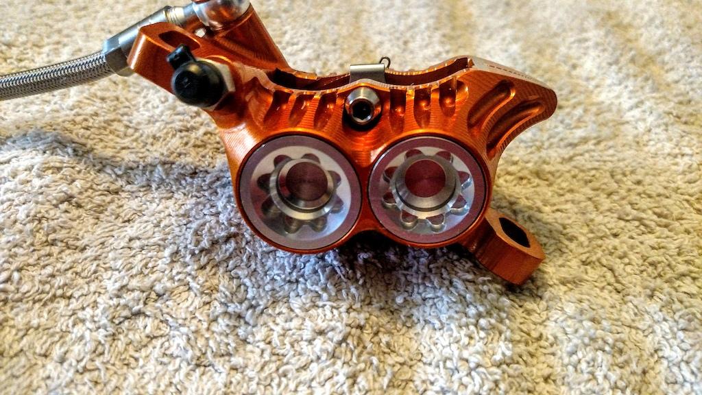 Hope V4 orange caliper with silver bore caps