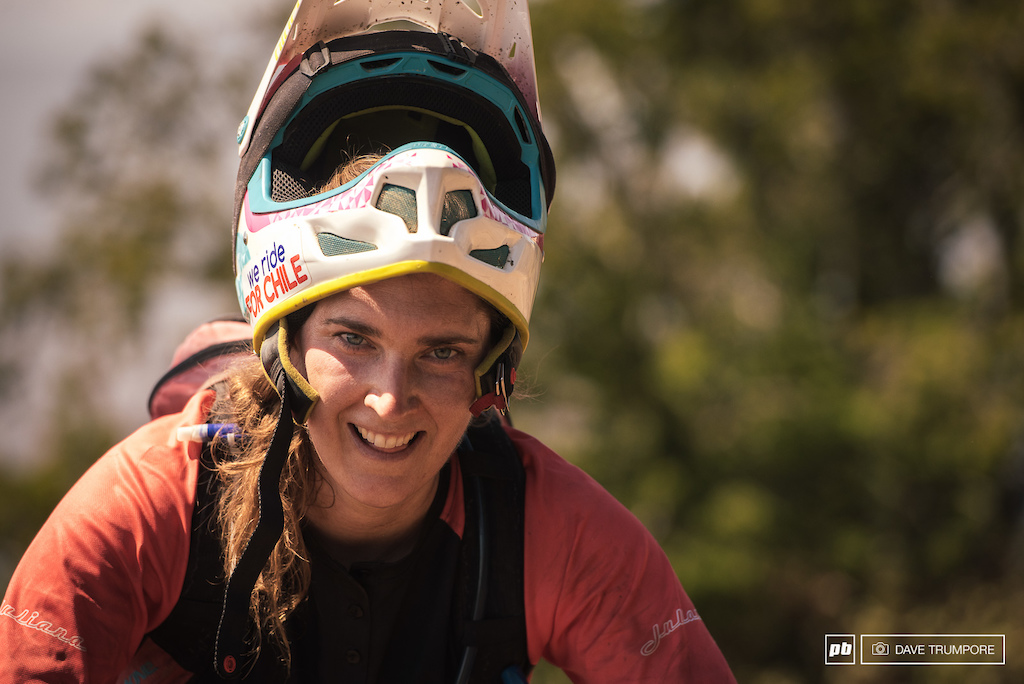 Canada s Emily Slaco smiles as she crests the finals climb of the 2017 Andes Pacifio. It was here first time racing this event and she would finish in an outstanding 2nd place behind Tracy Moseley.