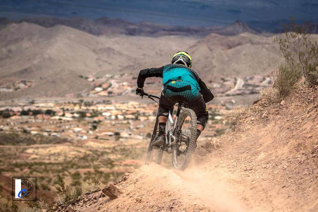 Steven Walton Commencal rails a skinny sidehill towards Boulder City.