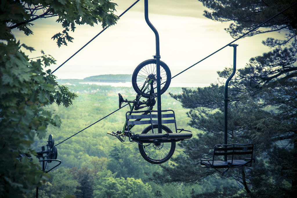Downhill mountain bikers ride the chairlifts at Marquette Mountain Ski Area in Marquette, Michigan.