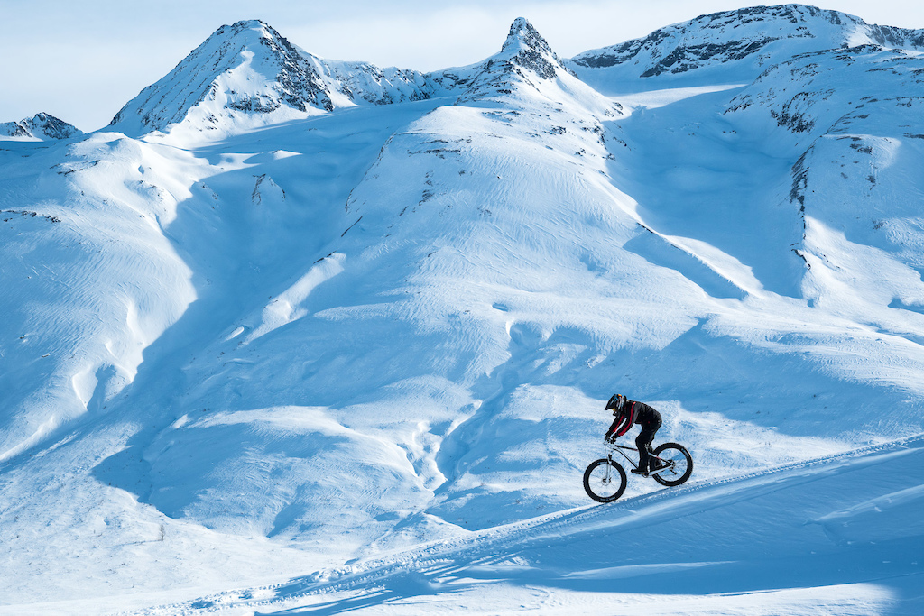 Russ riding what was most likely a first ever fat bike descent along a ridge near Thompson Pass.