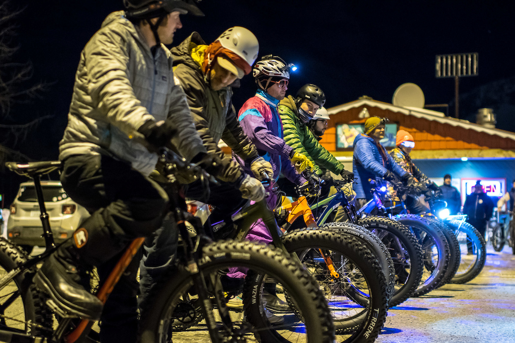 Hearty racers and fun seekers line up to brave the cold for a fat bike night crit on the cold empty streets of Valdez.