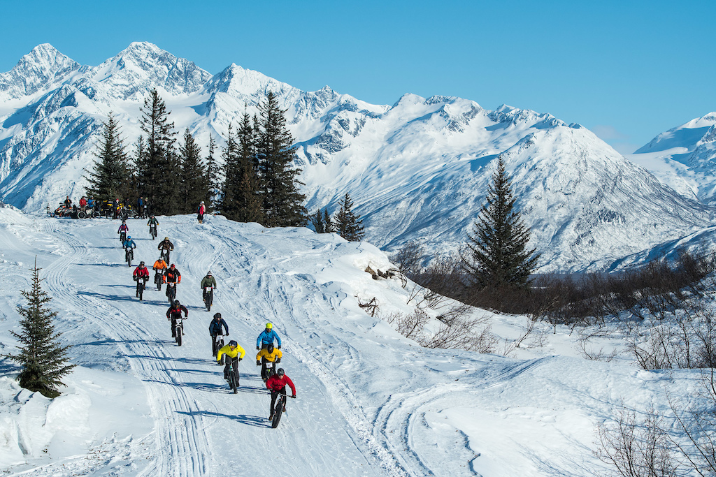 Noah Brousseau in red leads out the pack in the Meals DH mass start race but it was the local Alaskan Kevin Murphy in blue who took the win.