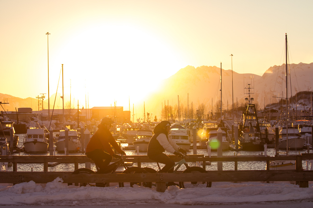 Noah Brusseau and Andrew Taylor cruise around the harbor at sunset. Photo Robb Thompson