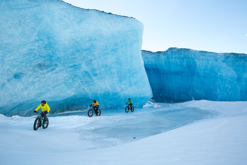 Exploring the Valdeze iceburgs by fatbike. Huge iceburgs which have broken off from the base of the Valdez glacier and then Photo Robb Thompson