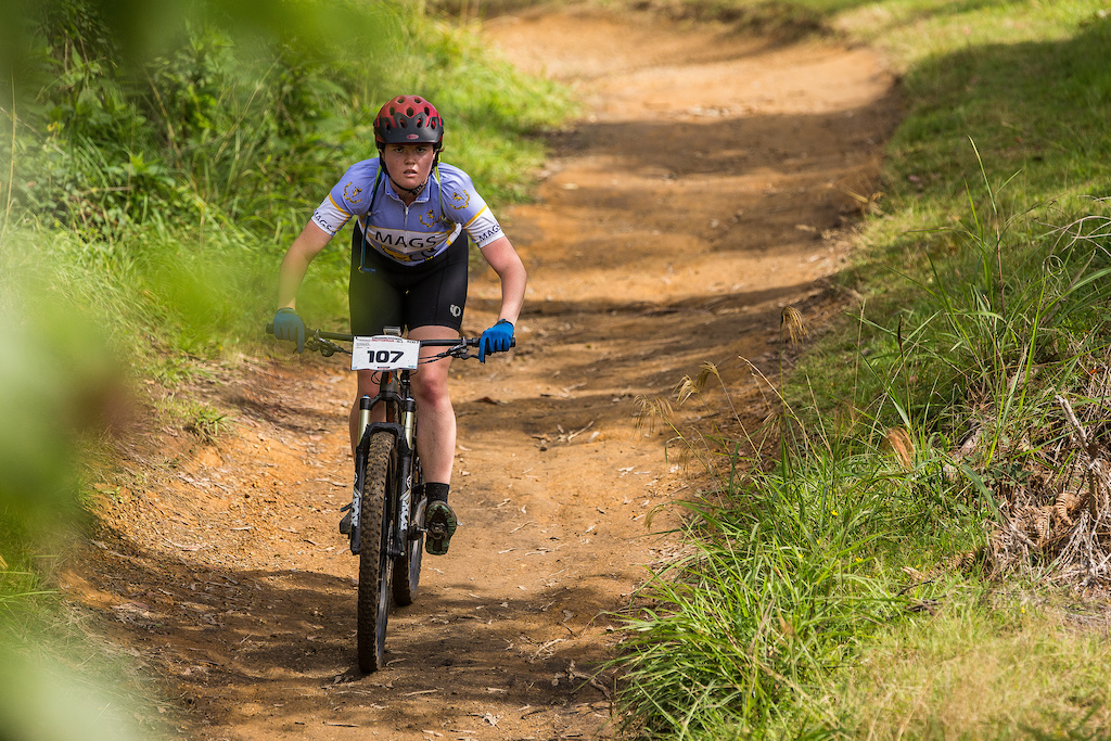 Annalise Gillespie heads for the feed zone at the Professionals Rotorua National Schools MTB Championships Presented by Altherm Window Systems. Credit Fraser Britton Crankworx