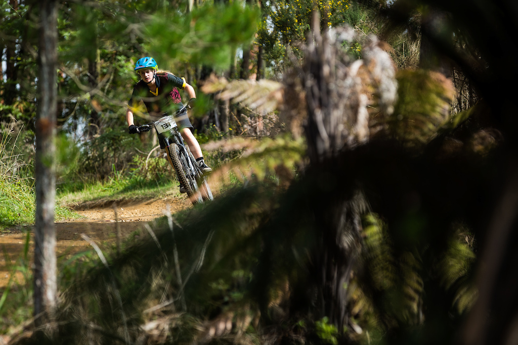 Millie Day attacks the singletrack at the Professionals Rotorua National Schools MTB Championships Presented by Altherm Window Systems. Credit Fraser Britton Crankworx