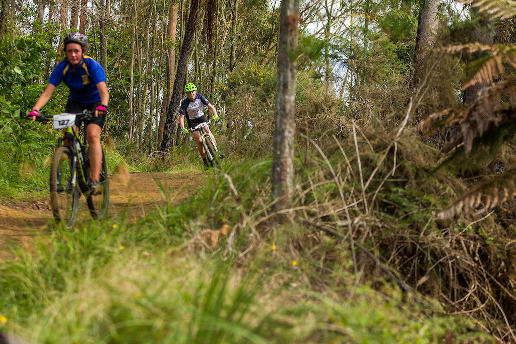 Emily Hannah chases down Jessica Guiney at the Professionals Rotorua National Schools MTB Championships Presented by Altherm Window Systems. Credit Fraser Britton Crankworx