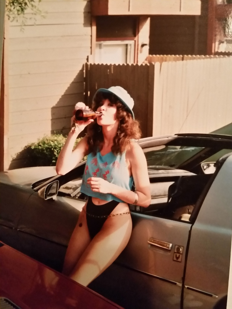 My partner in crime back in 1989. Leaning against her 1982 Pontiac Firebird with Cragar mags and t-tops at our apartment complex. Oh the good ol days, beer in hand etc.etc.