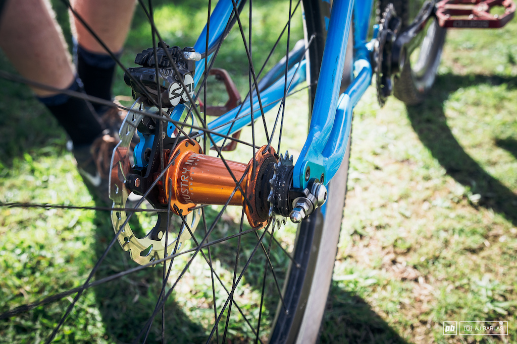 Industry Nine single speed hub laced to a Reynolds hoop. Shimano Saint brakes for stopping.