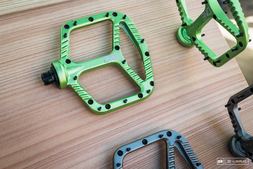 OneUp Components Alloy pedal in green. The pedal includes 10 pins side that can be removed to adjust the feel that you desire.