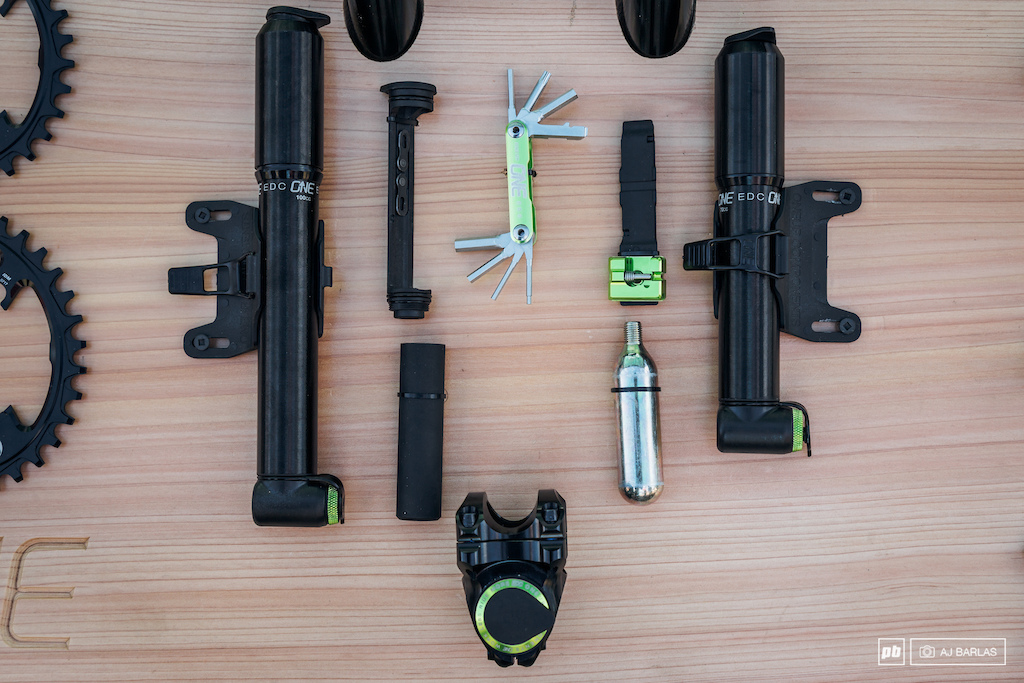 OneUp Components EDC Everyday Carry tool all of it s parts which include tire levers a multi tool C02 and chain tool as well as the high volume pumps that they are now producing too which also integrate with the EDC tool.