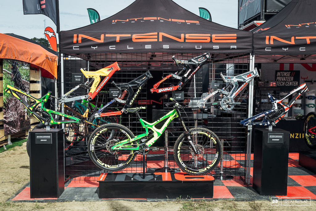 The history of Intense s M series downhill bikes on display.