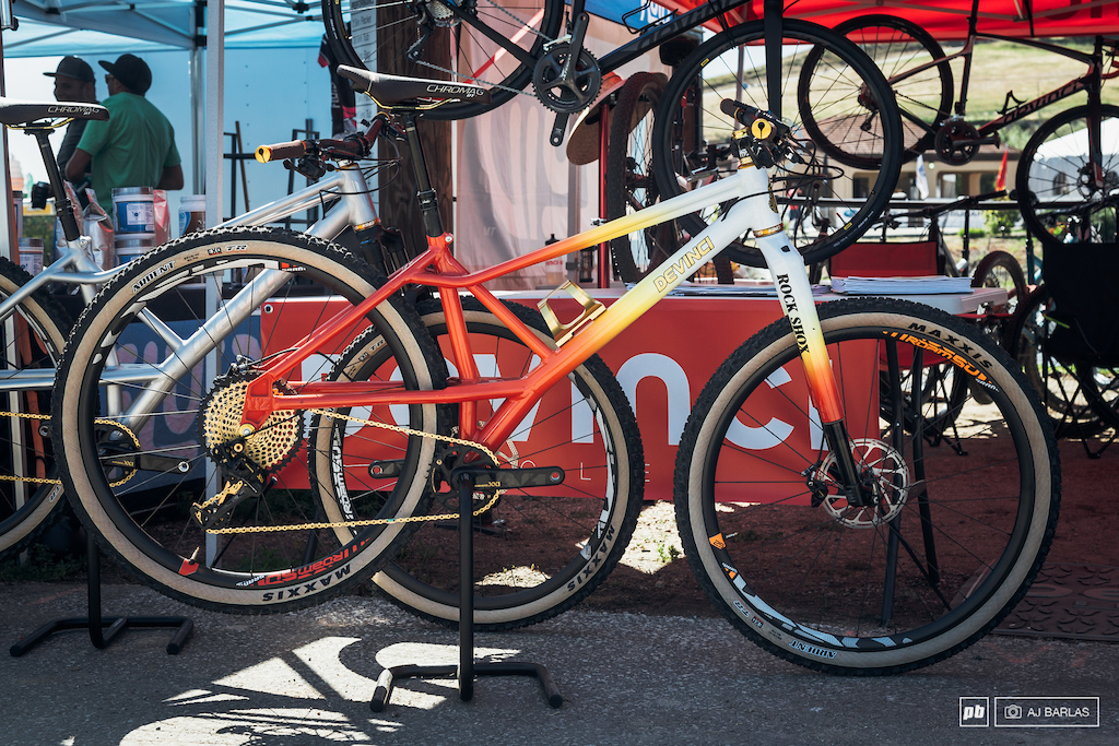 Devinci's YYZ in a candy looking white, yellow–red fade.