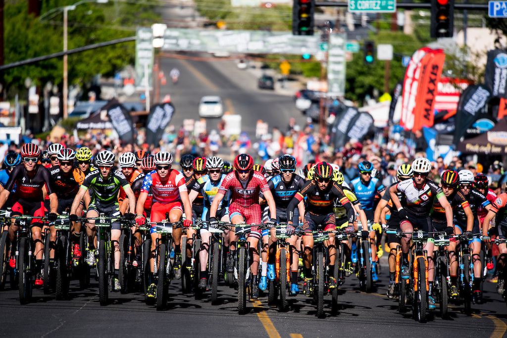 The pro men s field begin the climb out of downtown Prescott.