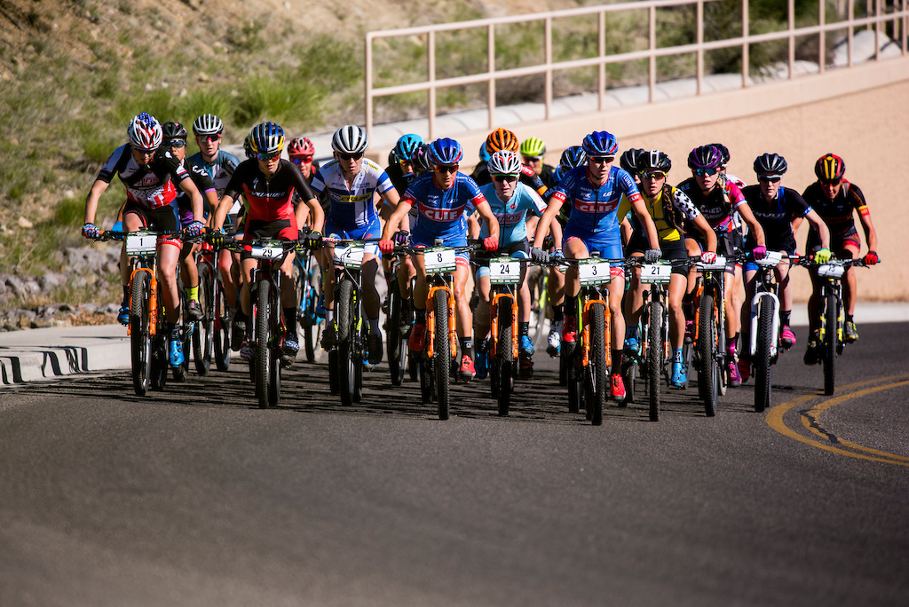 The pro women ride the pavement out of town Sunday.