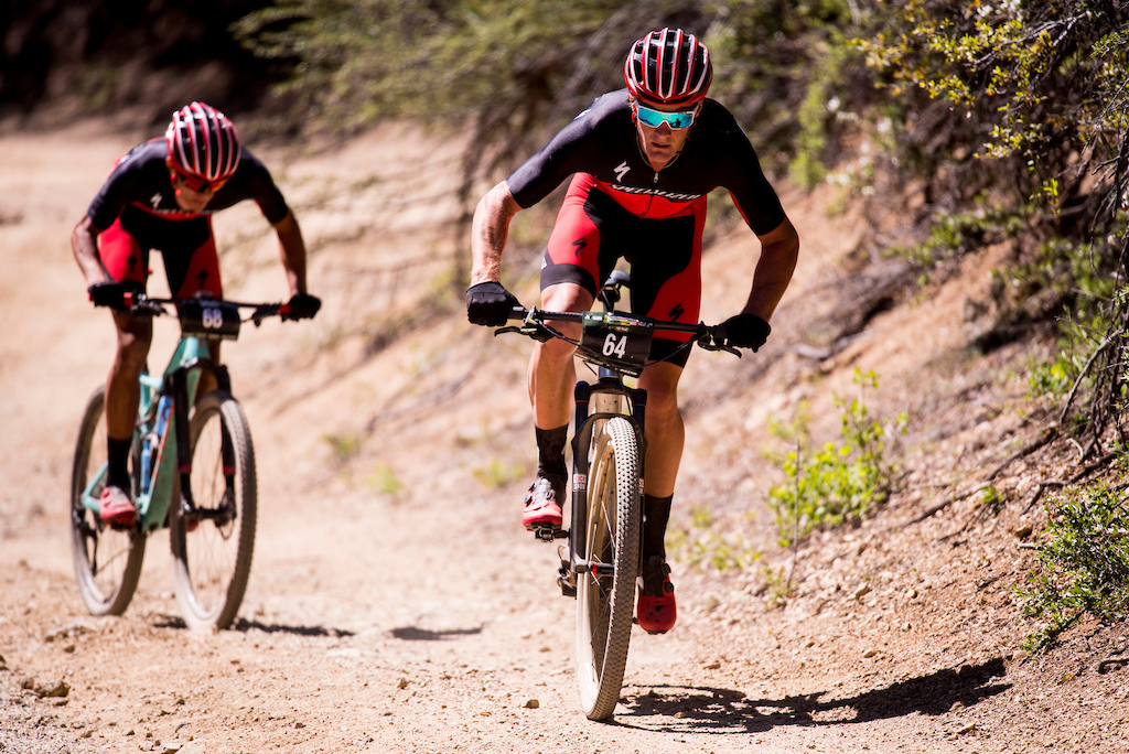 Sam Gaze leads Christopher Blevins up the climb before Skull Valley during Sunday s race.