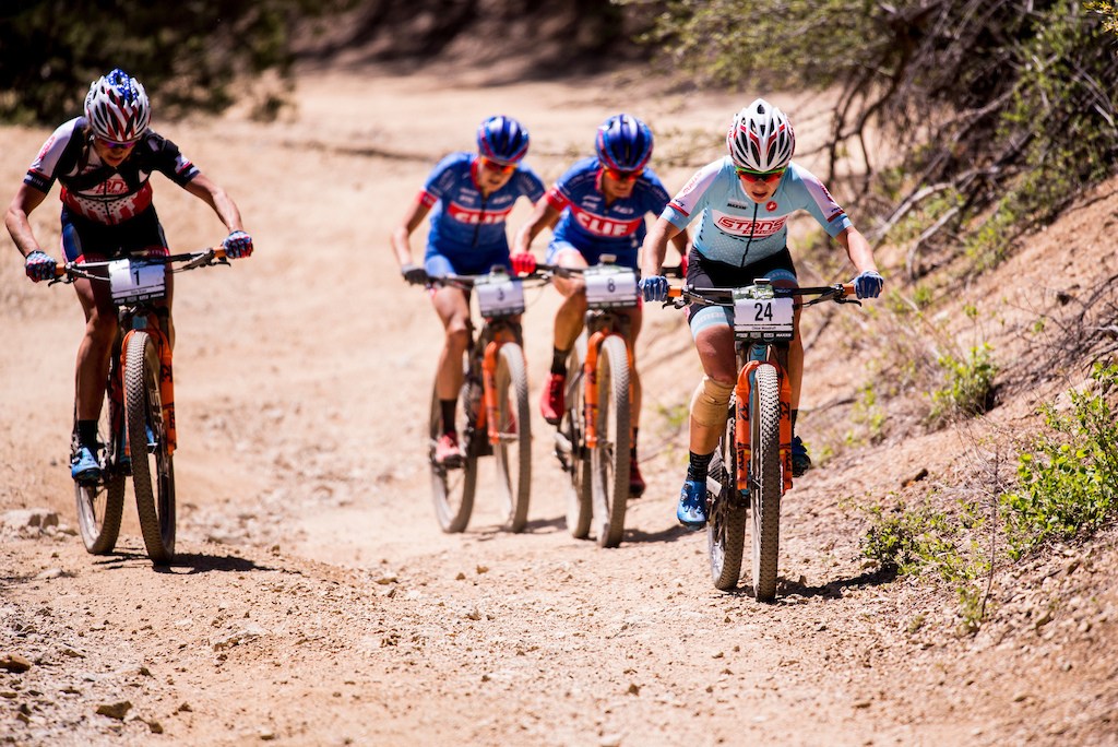 Chloe Woodruff leads Rose Grant Maghalie Rochelle and Katarina Nash up a fire road climb during Sunday s race.