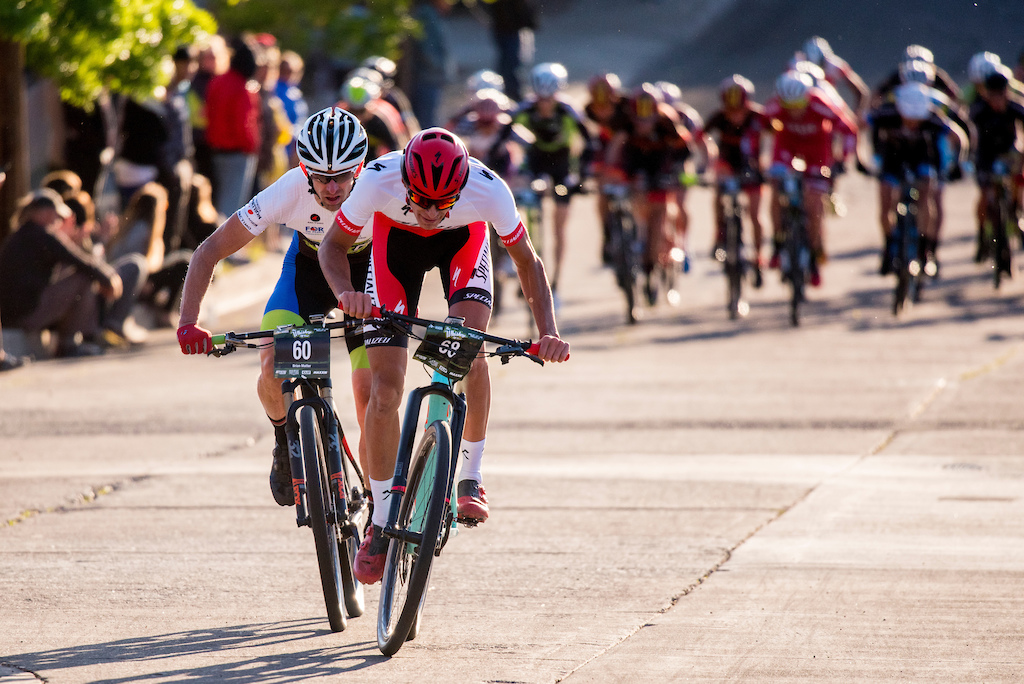 Brian Matter and Chis Blevins push the pace up the hill during the Fat Tire Criterium Friday.