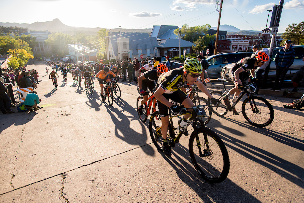 The men climb the hill as the sun sets over Prescott during the Fat Tire Criterium Friday.