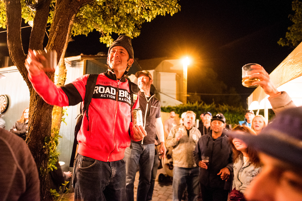 The crowd raises a toast the Zapata Espinosa on Saturday. The race was dedicated to the former mountain bike journalist who is a Mountain Bike Hall of Fame inductee.
